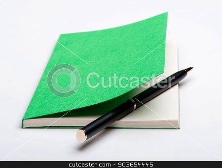 Green notebook and ballpoint pen stock photo, Isolated close-up of a ballpoint pen in a notepad on the white background by Evgeny Govorov