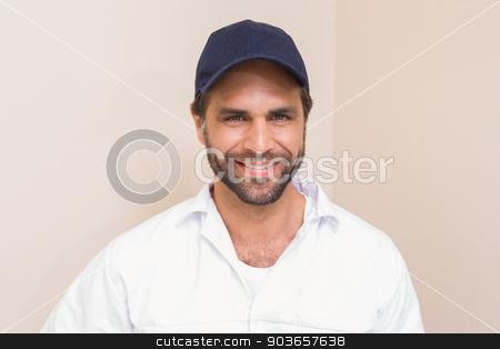 Handyman smiling at camera  stock photo, Handyman smiling at camera in a new house by Wavebreak Media