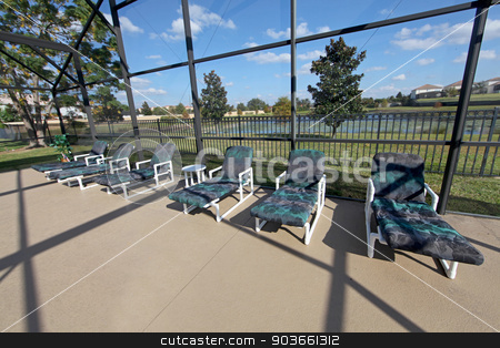 Patio stock photo, A Patio with Loungers and Lake View by Lucy Clark