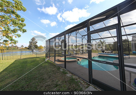 Pool Area stock photo, A Swimming Pool and Spa with Screen and Lake View by Lucy Clark