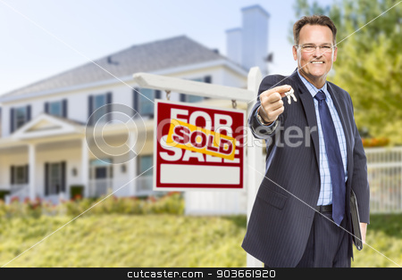 Agent with Keys in Front of Sold Sign and House stock photo, Real Estate Agent with House Keys in Front of Sold Sign and Home. by Andy Dean