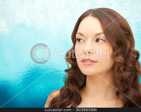beautiful young woman face stock photo, beauty, people and health concept - beautiful young woman face over ripple blue water background by Syda Productions