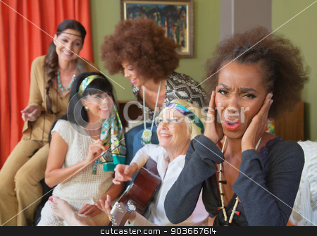 Hippies Playing Loud Music stock photo, Annoyed woman with group of hippies playing music by Scott Griessel
