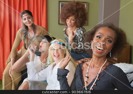 Woman Laughing at People Smoking stock photo, Woman laughing a middle aged group smoking pot by Scott Griessel