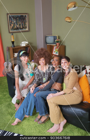 Hippies Sitting on Sofa stock photo, Group of four hippies sitting on leather sofa by Scott Griessel