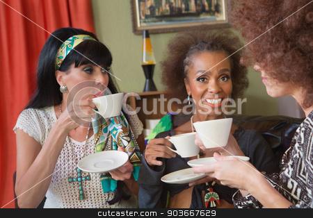 Smiilng Mature Women Having Tea stock photo, Group of three beautiful 1960s women having tea by Scott Griessel