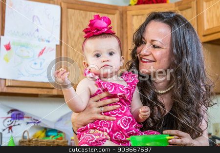 Mother Smiles at Baby stock photo, Mother in kitchen smiles at her baby by Scott Griessel