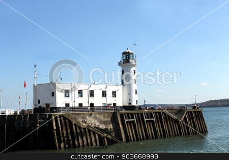 Scarborough harbor lighthouse stock photo, Scenic view of Scarborough harbor lighthouse in North Yorkshire, England. by Martin Crowdy