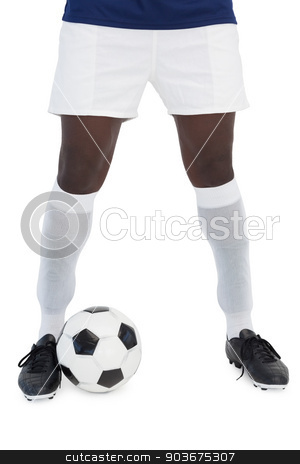 Football player standing with the ball stock photo, Football player standing with the ball on white background by Wavebreak Media