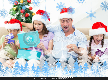 Composite image of family opening christmas presents stock photo, Composite image of family opening Christmas presents against snowflakes and fir trees by Wavebreak Media