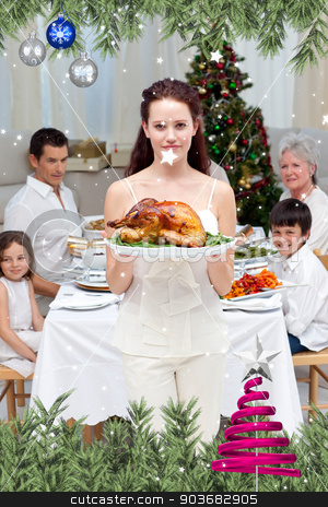 Mother showing turkey for christmas dinner stock photo, Mother showing turkey for Christmas dinner against twinkling stars by Wavebreak Media