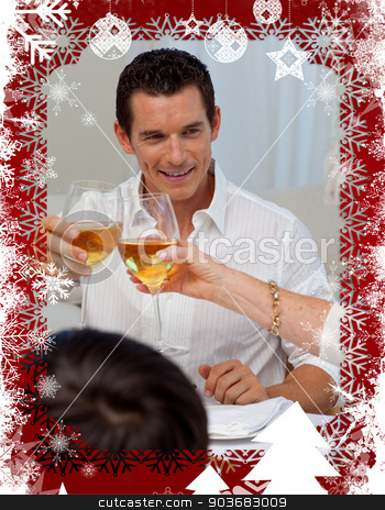 Man toasting with his mother in a christmas dinner stock photo, Man toasting with his mother in a Christmas dinner against christmas themed frame by Wavebreak Media