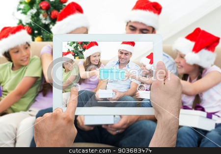 Composite image of hand holding tablet pc stock photo, Composite image of hand holding tablet pc showing photograph by Wavebreak Media