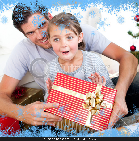 Happy little girl with her father receiving a christmas present stock photo, Happy little girl with her father receiving a Christmas present against snow flake frame in blue by Wavebreak Media