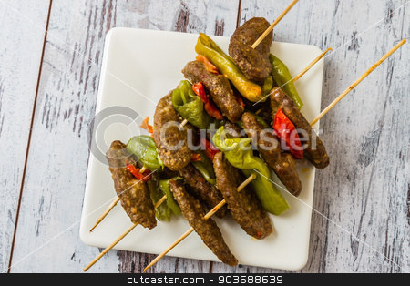 Meat Ball at Shish stock photo, Meat ball, green pepper, tomato at shish in ceramic white plate by OZMedia