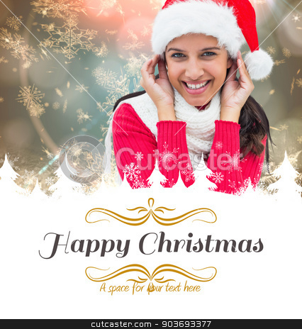 Composite image of festive brunette stock photo, festive brunette against border by Wavebreak Media