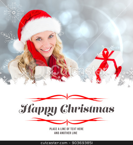 Composite image of happy festive blonde with gift stock photo, happy festive blonde with gift against border by Wavebreak Media