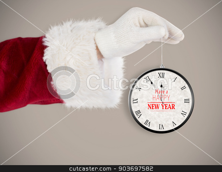 Composite image of santas hand is holding a christmas bulb stock photo, Santas hand is holding a Christmas bulb against grey background with vignette by Wavebreak Media