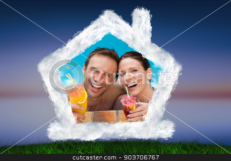 Composite image of beautiful couple drinking cocktails in the sw stock photo, Beautiful couple drinking cocktails in the swimming pool against green grass under blue and purple sky by Wavebreak Media