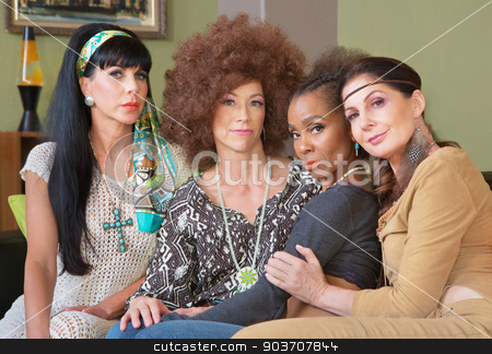 Four Diverse Best Friends stock photo, Diverse group of 1960s women sitting together by Scott Griessel