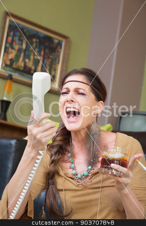 Woman Drinking and Singing at Phone stock photo, Single woman with drink singing into telephone by Scott Griessel