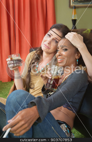 Drunk Women Embracing stock photo, Moping drunk women with cigarettes comforting each other by Scott Griessel
