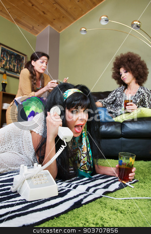 Drunk Woman Yelling Into Phone stock photo, Drunk female with friends yelling into telephone by Scott Griessel