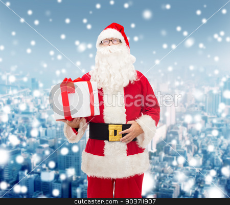man in costume of santa claus with gift box stock photo, christmas, holidays and people concept - man in costume of santa claus with gift box over snowy city background by Syda Productions