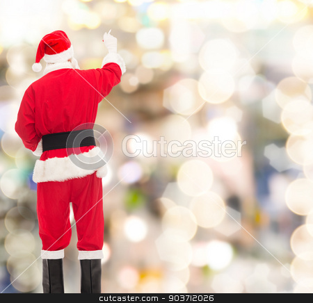 man in costume of santa claus writing something stock photo, christmas, holidays and people concept - man in costume of santa claus writing something from back over lights background by Syda Productions