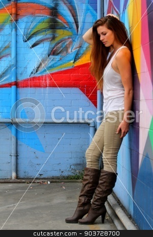 Young Woman stock photo, Young woman standing in front of a colorful background. by Henrik Lehnerer