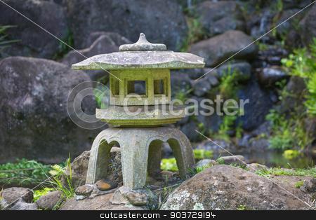 Asian Pagoda Sculpture stock photo, Beautiful Asian pagoda sculpture on rocks outdoors by Scott Griessel