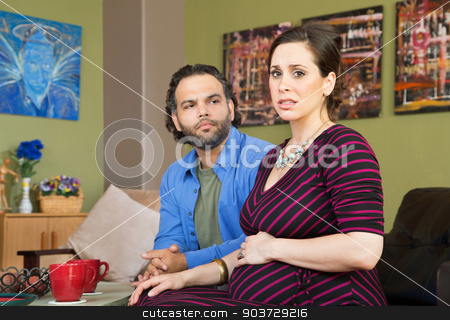 Couple Anxious About Pregnancy stock photo, Mixed married couple anxious about their pregnancy by Scott Griessel