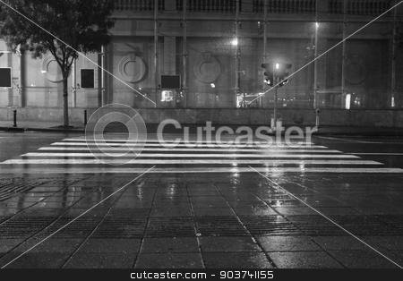 Long exposure traffic pedestrian crossing on rainy night stock photo, Long exposure in night traffic on road and pedestrian crossing  by Nebojsa Markovic