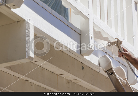 House Painter Spray Painting A Deck of A Home stock photo, House Painter Wearing Facial Protection Spray Painting A Deck of A Home. by Andy Dean