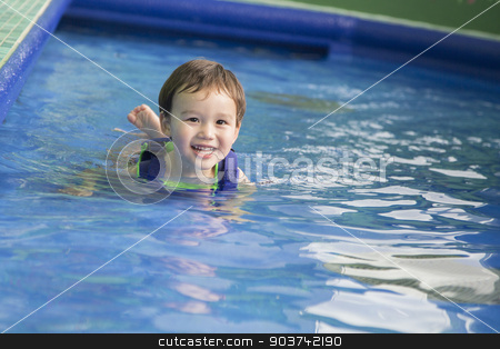 Mixed Race Boy Having Fun at the Water Park stock photo, Adorable Mixed Race Boy Having Fun at the Water Park. by Andy Dean