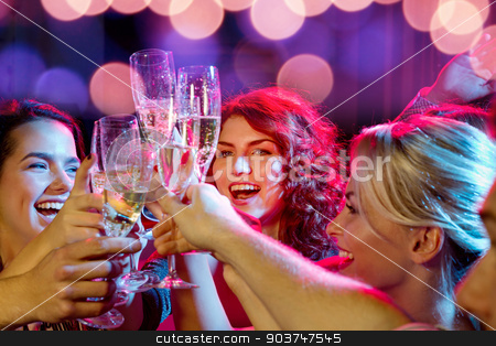 smiling friends with glasses of champagne in club stock photo, party, holidays, celebration, nightlife and people concept - smiling friends with glasses of champagne in club by Syda Productions
