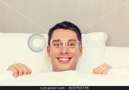 handsome sleeping in bed stock photo, hotel, travel, relationships, and happiness concept - handsome man in bed by Syda Productions