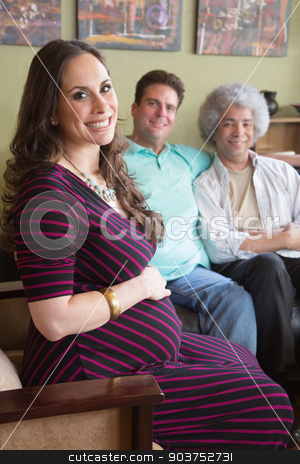 Pregnant Surrogate Woman with Parents stock photo, Grinning pregnant surrogate female sitting with happy parents by Scott Griessel