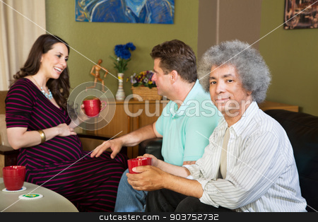 Surrogate mother with two same sex parents stock photo, Black man with male partner and pregnant surrogate female by Scott Griessel