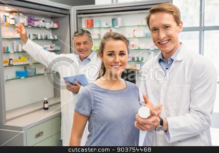 Happy customer talking with pharmacist stock photo, Happy customer talking with pharmacist at the hospital pharmacy by Wavebreak Media
