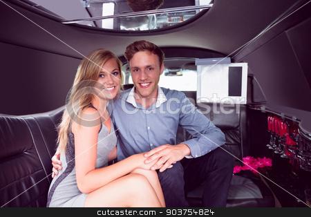 Happy couple smiling in limousine stock photo, Happy couple smiling in limousine on a night out by Wavebreak Media