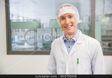 Happy pharmacist in a hairnet stock photo, Happy pharmacist in a hairnet at the hospital pharmacy by Wavebreak Media