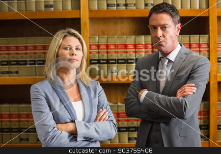 Lawyers looking at camera in the law library stock photo, Lawyers looking at camera in the law library at the university by Wavebreak Media