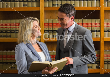 Lawyers reading book in the law library stock photo, Lawyers reading book in the law library at the university by Wavebreak Media