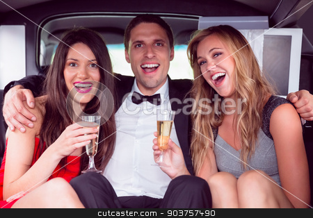 Pretty girls with ladies man in the limousine stock photo, Pretty girls with ladies man in the limousine on a night out by Wavebreak Media