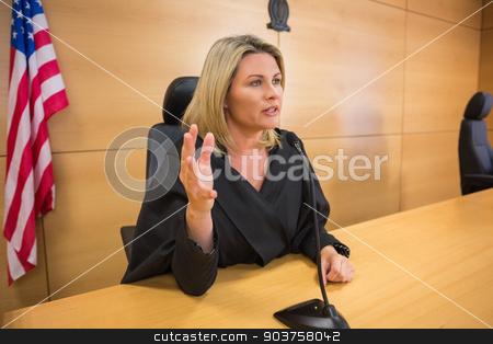 Stern judge speaking to the court stock photo, Stern judge speaking to the court in the court room by Wavebreak Media