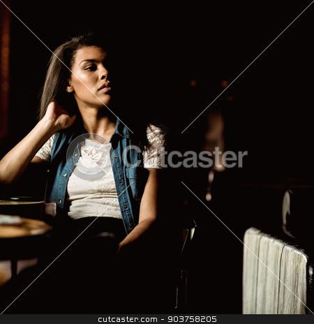 Pretty student sitting alone and thinking stock photo, Pretty student sitting alone and thinking in a pub by Wavebreak Media
