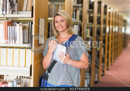 Mature student studying in the library stock photo, Mature student studying in the library at the university by Wavebreak Media