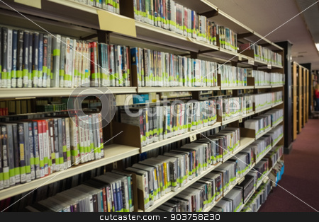 Rows of bookshelves in the library stock photo, Rows of bookshelves in the library at the university by Wavebreak Media