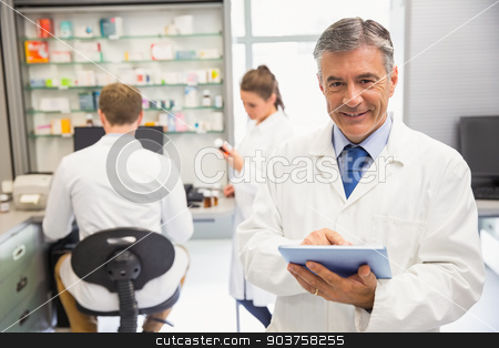 Senior pharmacist using tablet pc stock photo, Senior pharmacist using tablet pc at the hospital pharmacy by Wavebreak Media
